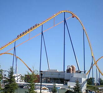 Behemoth (roller coaster) - A train climbs the 70 meter lift hill of Behemoth, which looms over the Backlot Stunt Coaster