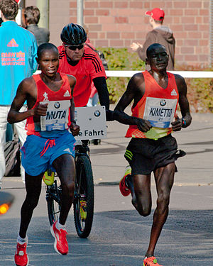 Dennis Kipruto Kimetto - Kimetto (right) at the 2012 Berlin Marathon