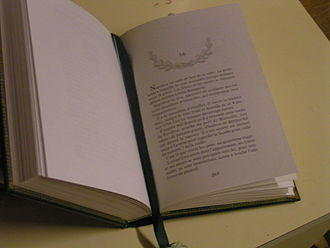 Bookmark - A book with a bound bookmark.
