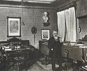English: The composer Johannes Brahms in his study