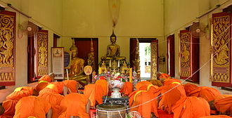 Buddhānusmṛti - Thai monks bowing to Buddha statue.