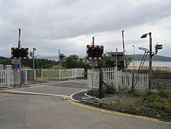 Bunchrew Level Crossing with new barriers (9569317021).jpg