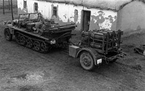 Sd.Kfz. 10 - A Sd.Kfz 10/1 gas detection vehicle towing a 28/32 cm Nebelwerfer 41 rocket launcher