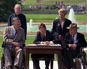 https://upload.wikimedia.org/wikipedia/commons/thumb/e/e8/Bush_signs_ADA.jpg/301px-Bush_signs_ADA.jpg