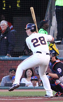 Buster Posey at the plate, with one leg lifted ready to swing at a pitch