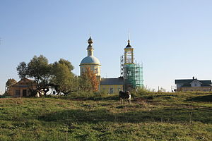 Holy Field - View at the St. Nicholas church from Buzhaninovo's village green