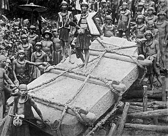 Prehistoric Indonesia - People on Nias Island in Indonesia move a megalith to a construction site, circa 1915.  Digitally restored.