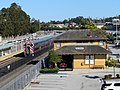 Caltrain passing old Millbrae station, July 2018.JPG