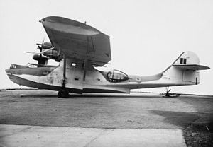 Llanfaes Friary - Catalina IVB 205 Sqn RAF, on the ground at Saunders-Roe's Friars site. The background was blanked out by a wartime censor to avoid showing the site details.
