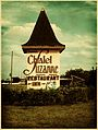 Chalet Suzanne highway sign colorized.jpg