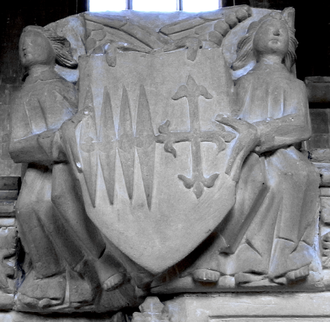 Ralph Cheyne - Sculpted escutcheon on monument to Sir Ralph Cheney in Edington Church showing the arms of Cheney impaling Paveley: Azure, a cross flory or