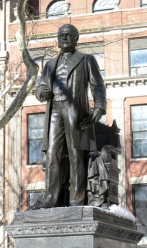 Bronze statue of a man in a city park