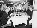 Christmas dinner in the wardroom of HMS MALAYA at Scapa Flow, 25 December 1942. A13568.jpg
