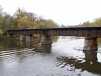C&O Railroad over the Kalamazoo River. Note the two piers closest together. The second pier was a center pivot to allow the bridge to open and boats to pass.