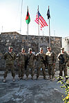 Coin ceremony at COP Monti 121230-A-TT389-077.jpg