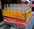 Coke Coca-Cola crate with old glas bottles.JPG