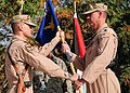 Col. Bryan Bartlett, 438th Air Expeditionary Vice Wing Commander, passes the guidon to Lt. Col. Michael Needham.jpg