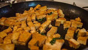 Frying - Tofu being fried