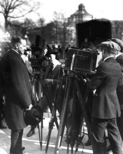 Coolidge, reporters, and cameramen