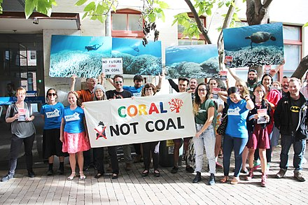 Protesting damage to the Great Barrier Reef caused by climate change in Australia Coral not coal protest at India Finance Minister Arun Jaitley Visit to Australia (25563929593).jpg