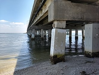 Corrosion engineering - 'Pile jackets' encasing old concrete bridge pilings to combat the corrosion that occurs when cracks in the pilings allow saltwater to contact internal steel reinforcement rods
