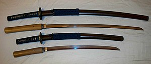 Antique Japanese (samurai) daishō, the traditional pairing of two Japanese swords which were the symbol of the samurai, showing the traditional Japanese sword cases (koshirae) and the difference in size between the katana (top) and the smaller wakizashi/kodachi (bottom).
