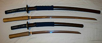 Japanese martial arts - A matched set (daisho) of antique Japanese (samurai) swords and their individual mountings (koshirae), katana on top and wakisashi below, Edo period.
