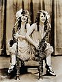 Daisy and Violet Hilton, conjoined twins, with saxophones. P Wellcome V0029581.jpg