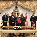 Dan Stoenescu signing an agreement during the official visit of FM Melescanu.jpg