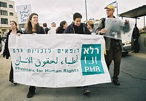 Physicians for Human Rights–Israel - Physicians for Human Rights–Israel participating in an anti-occupation demonstration at the Qalandia checkpoint, March 2002