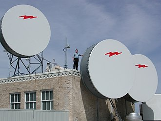Wireless broadband - Three fixed wireless dishes with protective covers on top of 307 W. 7th Street, Fort Worth, Texas around 2001
