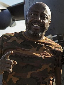 Donnell Rawlings stands in front of a C-17 Globemaster III (32666816002) (cropped).jpg