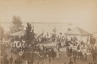 Toronto Ferry Company - People waiting for the ferry at the Doty Company Ferry docks at Hanlan's Point, circa 1885-95, by F.W. Micklethwaite