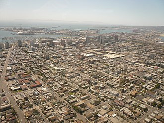 Downtown Long Beach - Aerial view of downtown Long Beach, California, looking southwest. San Pedro Bay and the Port of Long Beach are visible beyond, with Catalina Island faintly visible on the horizon.
