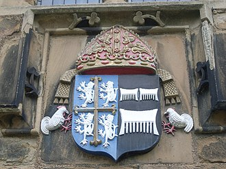 "Cuthbert Tunstall - Arms of Bishop Cuthbert Tunstall, Durham Castle. See of Durham impaling Tunstall (Sable, three combs argent), ""which arose from the first of the name and family in England, being barber to William the Conqueror"""