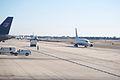 EM Line up awaiting for gates at Orange County (2603430692).jpg