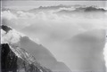 ETH-BIB-Bristen, Reusstal, Winterstock, Berneralpen im Nebel v. N. O. aus 3300 m-Inlandflüge-LBS MH01-003951.tif