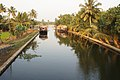 Early evening along the canals of Alleppey (6815553591).jpg