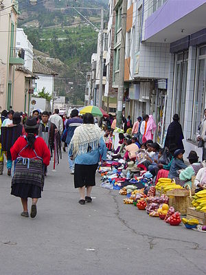 Ambato, Ecuador - On Mondays, vendors and buyers crowd streets and markets in Ambato.