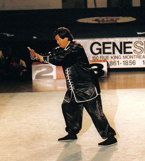 "Tai chi - Wu-style master Eddie Wu demonstrating the form ""Grasp the bird's tail"" at a tournament in Toronto, Ontario, Canada"