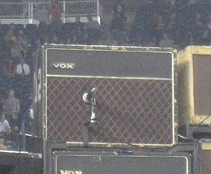 Vox AC30 - The Edge's almost-original Vox AC30/6 from 1964, housed in a '70s cabinet on stage. It is known that it is the 'brilliant' model (or top boost) and it was Edge's earliest amp used to record every U2 album