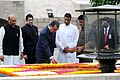 Emomali Rahmon, paying floral tributes at the Samadhi of Mahatma Gandhi, at Rajghat, in Delhi on September 03, 2012. The Minister of State for Defence, Dr. M.M. Pallam Raju is also seen.jpg