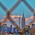 Empire State Building through a fence.jpg