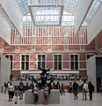Entrance hall Rijksmuseum in the digged out courtyards with cafe and shop - panoramio.jpg