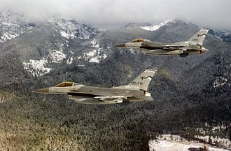 186th Airlift Squadron - Two U.S. Air Force General Dynamics F-16C Block 30D Fighting Falcon aircraft from the 186th Fighter Squadron Vigilantes, 120th Fighter Wing, Montana Air National Guard, in flight near Nellis Air Force Base, Nevada (USA), on 7 December 2001.