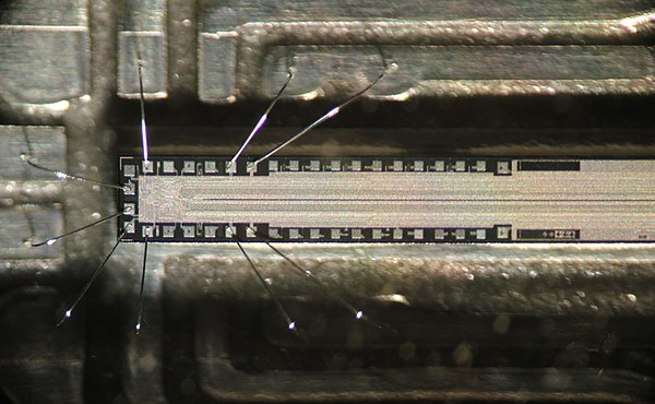 The chip in a fax machine. Only about one quarter of the length is shown. The thin line in the middle consists of photosensitive pixels. The read-out circuit is at left. Faxchip.jpg