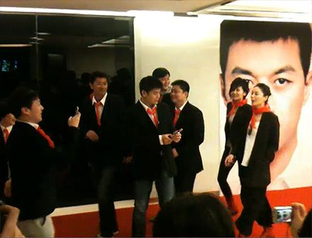 Wong (far right) and friends attend the Beijing premiere of Eternal Moment (starring Li Yapeng), all wearing red scarves which symbolizes youth in China, February 2011 Faye wong eternal moment.jpg