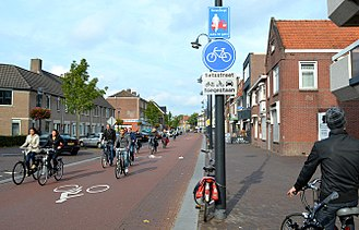 """Transport in the Netherlands - A ''fietsstraat'' (bike street) where cyclists have priority and cars are """"guests"""" and must yield."""