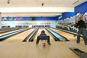 Five-pin bowling - A boy five-pin bowling