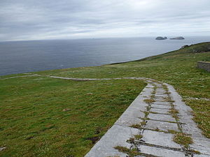"Flannan Isles Lighthouse - The remains of the Flannan lighthouse railway as of 2012. This view is looking approximately west-south-west from the lighthouse. The site of ""Clapham Junction"" is just visible at left centre."